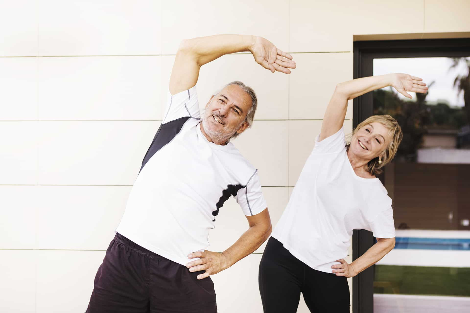 senior couple exercise stretch